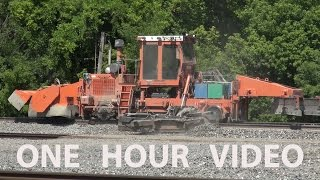 Download Heavy Equipment Railroad Track Maintenance with trains passing work zone - Berea, Ohio Video