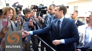 Download Macron gladly greets supporters after winning first round in France's presidential race Video