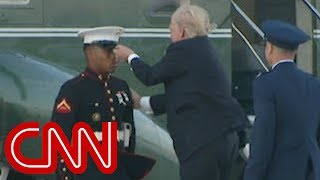Download Trump stops to retrieve Marine's hat Video