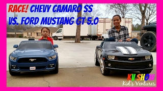 Download Racing The Power Wheels Ride On Ford Mustang GT 5.0 Vs. Chevy Camaro SS 12 Volt Video