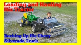 Download Loading/Hauling His Tractor! Backing Up His Power Wheels Chevy Silverado and Custom Tilt Trailer Video