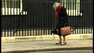 Download MP Fail: Theresa May gets her heel stuck outside Number 10 Downing Street Video
