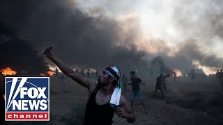 Download Tens of thousands protesting at Israeli-Gaza border Video