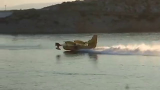 Download Canadair CL-415 water bombers, and idiots with boats Video