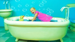 Download Nastya playing in the playhouse of Peppa toy in the amusement park Video