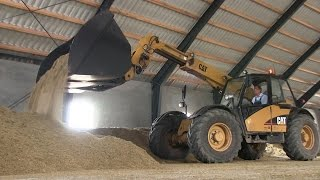 Download Caterpillar TH330B Telehandler Stacking Grains At The Barn | Harvest 2015 Video
