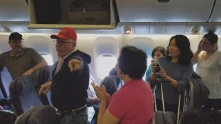 Download Man In Trump Hat Gets Escorted Off United Flight Video