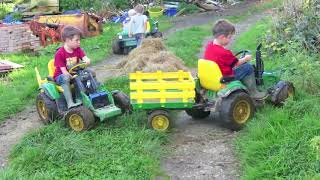 Download Kids Playing on ride on tractors loading hay, children play on the farm Video