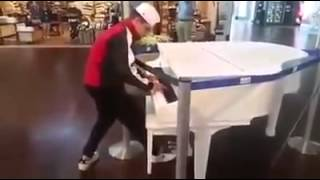 Download Kid surprises and amazes on public piano Video