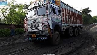 Download Indian Road vs Indian Trucks -Tata 3118c Trucks & Tata 2515 Tanker At Mud Road. Video