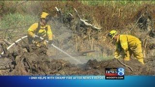 Download DNR investigates smoldering 'swamp fire' Video