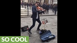 Download Street artist dazzles spectators with epic violin performance Video