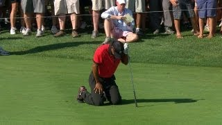 Download Tiger Woods drops to his knees in pain during final round of The Barclays Video