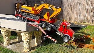 Download BRUDER TRUCK Mack and CAT Excavator crash in Bridge! Video