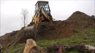 Download Backhoe Bailing Dirt Video