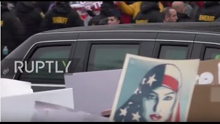 Download USA: Protesters line the route as Trump heads to the White House Video