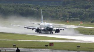Download Brand NEW Boeing 737 MAX Impressive reverse thrust landing on wet runway Video