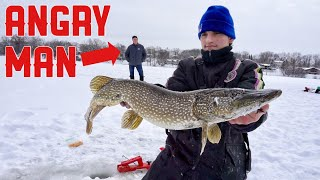 Download Ice Fishing HUGE Pike In Front of PISSED OFF HOMEOWNER!! Video