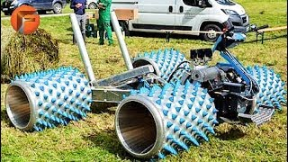 Download HUGE Lawnmower mows grass like a Mad Machine Video