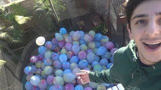 Download TRAMPOLINE FILLED WITH BALLOONS (BROKEN WRIST) Video