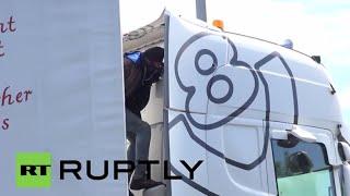 Download France: Desperate migrants target lorries amid Calais unrest Video
