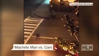 Download Caught on camera: Machete-wielding man hit by passing car Video