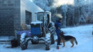 Download Starting an air cooled tractor in winter. Featuring T-40AM Russian tractor Video