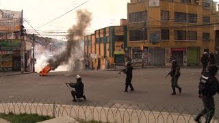 Download Bolivian coca farmers clash with police over output curb Video