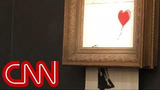 Download Watch Banksy's $1.4 million painting 'self-destruct' Video