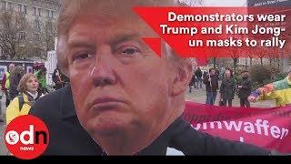 Download Demonstrators wear Trump and Kim Jong Un masks to rally Video