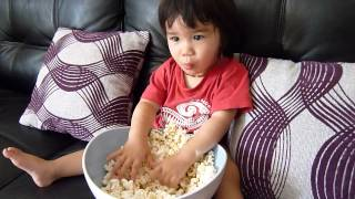 Download 17 months old baby eating popcorn for the first time Video