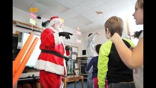 Download The Singing Santa visits Wilson Elementary School Video
