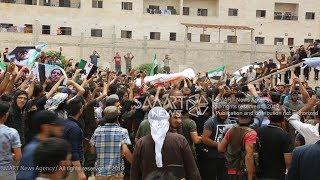 Download تشييع جثمان ″الساروت″ إلى مثواه الأخير في مقبرة الدانا بإدلب Video