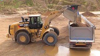 Download New Cat 980M Wheelloader Loading Volvo FH12 Semi Trucks Video