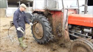 Download Fitting a new tyre to the Massey Ferguson 135. Part 2 Video