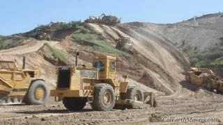 Download Fleet of 657 scrapers bringing down hill Video