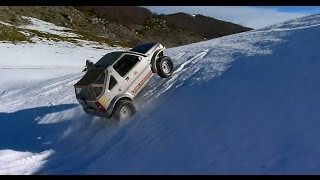 Download Suzuki Jimny Vs Suzuki Gran Vitara on the snow. Video