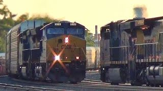Download 2 CSX Trains Meet at Railroad Crossing Video
