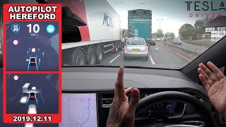 Download Tesla Autopilot in a UK City #1 - Can it navigate 4 lanes & drivers cutting in traffic?! (Hereford) Video