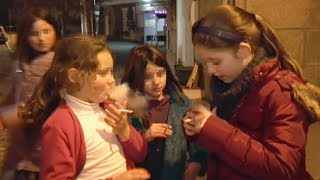 Download Parents encourage their children to smoke cigarettes in a Portuguese village Video