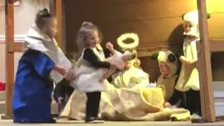 Download Kid Hilariously Steals Baby Jesus From Manger During Live Nativity Scene Video
