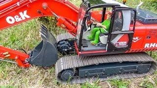 Download BIG RC Excavator Action! Caterpillar, Liebherr & Co working hard! Video