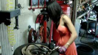 Download Asian Lady Who Changes Tires In A Dress Video