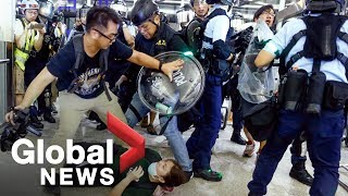 Download Hong Kong police face off with protesters as airport protests erupt in chaos Video