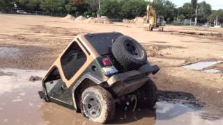 Download jeep got stuck in what seems to be a puddle Video