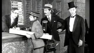 Download ON THE FRONT PAGE 1926 STAN LAUREL Video