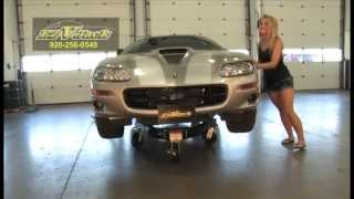 Download Girl moves car with rolling jack stand Video