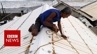 Download Philippines Typhoon Mangkhut: 'People are tying down their roofs' - BBC News Video