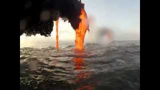 Download Amazing footage of lava creating a black sand beach Video