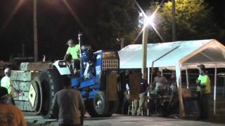 Download Rear Wheel Comes Off Of Tractor During Pull On Concrete Video
